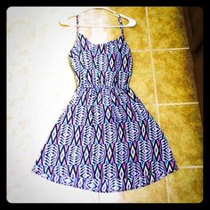 Shop Hopes tribal dress! This tribal dress is colorful, beautiful, and excellent for the summer! This great quality dress has an open back and pockets in the front! Shop Hopes Dresses