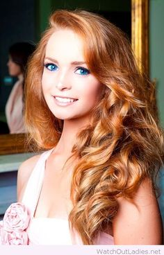 Stunning red hair and blue eyes, beauty