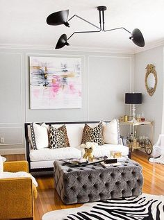 They key to a seriously chic living room: an oversize tufted ottoman!