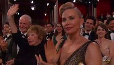 Better times: MacLaine was all smiles and gave her brother a big wave as he came out on stage Sunday (above next to Charlize Theron)