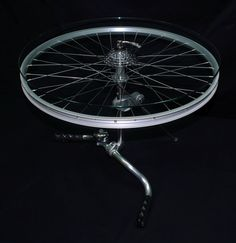 Gira La Ruota. Coffee-Table, made from recycled bicycle parts.Design and copyright by Anna Maria Gori