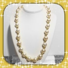 "22"" Large Pearl & Gold Bead Necklace Beautiful costume jewelry with large iridescent off-white/cream faux pearl beads, gold color beads between each faux pearl, and spring ring clasp. Length is 22"". Clasp is somewhat tarnished but 100% functional. Great pre-loved condition! ⭐️⭐️⭐️⭐️ ✅ASK QUESTIONS ✅Bundle ✅Offers ❌NO Trades ❌NO Off-Site Transactions Jewelry Necklaces"