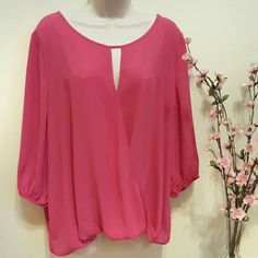 1hr ⚡Sale! Vince Camuto bright pink blouse Discounted shipping for 1 hour!  Gorgeous semi-sheer light flowy blouse. Excellent gently used condition, no flaws that I can find. Key hole in the front, with crossover look. Tiny elastic along the hem in the back, and also at the sleeve hems - as shown in 3rd pic.  See the current Sale Ad at the top of my closet ⭐ Bundle & Save ⭐ or Make an Offer! Vince Camuto Tops Blouses