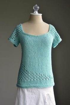 Free knitting pattern for Swoop Tee Pattern - Designed by Amy Gunderson, this top with lace detail on the sleeves and near hem. Small (Medium, Large, 1X, 2X)