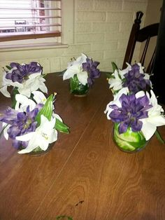 Diy flower centerpiece wedding baby shower bridal shower fish bowl vase lined with large leaf white and purple
