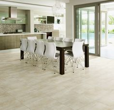 Photo features Daltile Sheer Glow 12 x 24 field tile in a grid pattern on the floor. Backsplash features Color Wave Classic 3 x 6 field tile in Suede Shoes and 1 x 1 blend in Downtown Oasis. Kitchen Tiles, Kitchen Flooring, Julie's Kitchen, Tile Flooring, Bathroom Flooring, Dal Tile, Flooring Store, Wood Look Tile, Kitchen Lighting Fixtures