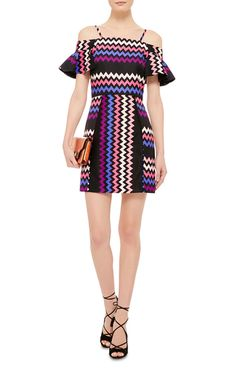 Textures, colors, silhouettes and influences are remixed in Massimo Giorgetti's sartorial turntable at MSGM; no surprise, considering his background as a DJ. This **MSGM** dress features a bold chevron print, and flared off-the-shoulder sleeves.