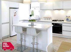 No handles. Note white fridge with black/stainless steel oven..
