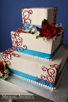 Red, White, & Blue #84Ribbons his cake is made up of three square layers. Swirls and ribbon can be decorated in a variety of different ways to make it your own unique design. Colored icing can also bring a different look to your wedding cake.