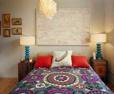 Eclectic bedroom with mismatched nightstands and twin bedside lamps [Design: Ondine Karady Design]