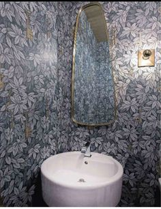 stunning Fornasetti by Cole and Son wallpaper with mid-century mirror