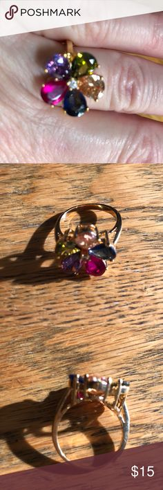 Multi-color flower ring Gold tone ring with beautiful stones. Size 8 Jewelry Rings