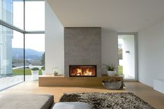 modern and sleek, say no more! except the cement slab may be subjected to the uneven heat depends on the distance to the actual fire, cracks? Linear Fireplace, Home Fireplace, Fireplace Surrounds, Fireplaces, Wood Insert, Log Burner, Hearth And Home, Firewood, Living Area