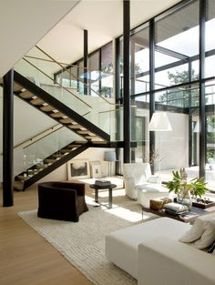 Almost perfect! Dark stringers, wood treads, floating glass stair rails w/wood hand rail
