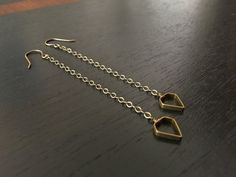 geometric brass dangle earrings by createyourhappy on Etsy