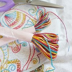 Envisioning embroidery floss for a project that just doesn't exist? Check out this easy DIY to make your own variegated/tie dyed thread!
