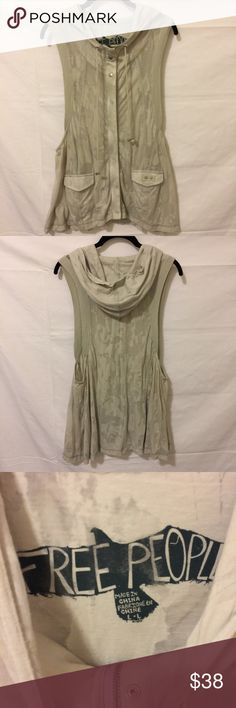 FREE PEOPLE Tan Burnout Sleeveless Zip Vest Top FREE People tan colored vest with a hood and no sleeves. Has two front pockets and has two marks of light tanner that go on the fabric. May be removable! Size large. Free People Jackets & Coats Vests