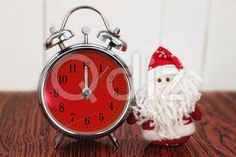 Qdiz Stock Photos | Santa Claus or Father Frost and retro alarm clock,  #alarm #analog #antique #background #beard #celebration #Christmas #Circle #classic #Claus #Clause #Clock #closeup #color #colorful #deadline #decoration #decorative #doll #eve #face #Father #figure #front #frost #fun #funny #greeting #holiday #hour #little #Merry #midnight #new #object #old #red #retro #Santa #small #Time #toy #traditional #twelve #vintage #white #wooden #xmas #year