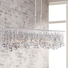 A large modern chandelier design in a classic crystal and chrome, from the Vienna Full Spectrum Luminous Collection.