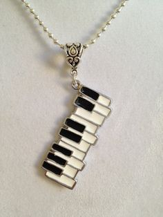 Piano Keyboard Necklace - if this was a brooch, I would definitely consider! It's so cool!