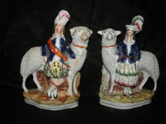 PAIR ANTIQUE STAFFORDSHIRE FIGURES OF BOY & GIRL STANDING IN FRONT OF SHEEP