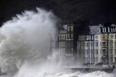 A large wave crashes over the promenade at high tide in Aberystwyth, Wales, as Britain endured more floods and winds. Description from thesecretmoongarden.ning.com. I searched for this on bing.com/images