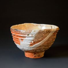 Yunomi (tea cup) - Natural wood ash with shino glaze, Woodfired Natural wood ash: pottery surface is left unglazed and takes on color and markings during the firing from the melted wood ash 4 x 4 x 3 inches Shipping and Policy (y-148-a)