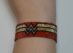 Wonder Woman NYCC Sparkling Japanese seed by DollyPopJewelryShop This is a fun Wonder Woman style bracelet made of seed beads and woven by hand off-loom. This bracelet will fit all wrists from 6 Bead Loom Patterns, Jewelry Patterns, Bracelet Patterns, Beading Patterns, Beading Ideas, Beading Supplies, Bead Loom Bracelets, Peyote Bracelet, Peyote Beading