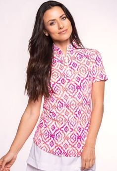 #lorisgolfshoppe Women's Golf Apparel offers a classy collection of golf skorts, shorts, dresses, and golf tops. Unique , Pretty Colors are the highlight of the Ibkul ladies golf collection just like this Pink/Coral Ibkul Ladies Hollie Print Short Sleeve Mock Neck Golf Shirt!
