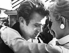 James Dean photographed by Phil Stern outside Schwab's Drugstore, Hollywood, May 1955.