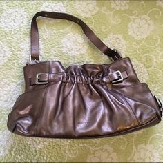 """Kenneth Cole bronze handbag like new Kenneth Cole bronze handbag like new. More of a brown than a gold bronze. 8""""H x 15""""L Bundle deals available (I carry various sizes and brands): 2 items 10% off, 3 items 15% off, 4 items or more 20% off  Kenneth Cole Bags Shoulder Bags"""