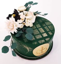 This is GORGEOUS! The most perfect emerald green (or British Racing Green?) cake is stencilled with a gold dust geometric pattern and then softened with a spray of sugar flowers. I LVE it.
