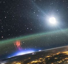 ISS astronaut photographs a super-rare 'red sprite' above a lighting storm.