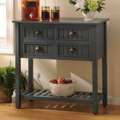 The Blue Beadboard Console Table adds country charm to your home while also bringing color and storage.