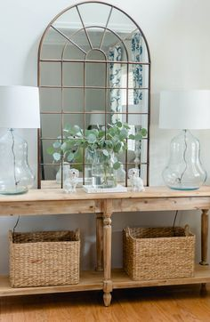 Welcome your guest in style with a pretty entry Everett foyer table styling with pretty lamps arch mirror and baskets thehomeicreate entrywaydecor entrywaydecorideas entryway foyerdecorating foyerdesign lampmakeover Foyer Design, House Design, Entry Way Design, Living Room Designs, Living Room Decor, Mirrors In Living Room, Foyer Decorating, Decorating Ideas, Home Decor Inspiration