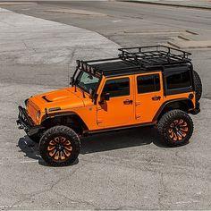 Orange Jeep Wrangler JK 4dr orange black wheels cargo basket off road lights