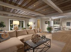 Stylish basement with reclaimed hardwood ceiling