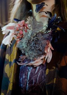 Feathers and flowers at Dries Van Noten AW15 PFW. See more here: http://www.dazeddigital.com/fashion/article/23955/1/dries-van-noten-aw15