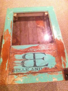 Belle and Ella logo painted and distressed on coffee table.