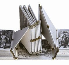 Neo Emblemata Nova by Dan Kelm, 2005. Book's form is Möbius strip, a 1-sided object. Half-twist in the looped structure allows reader to view entire book w/out ever turning it over. Images from Emblemata Nova, a 17th-century alchemical emblem book by German doctor Michael Maier. Wire edge binding, soldered brass & laser-welded stainless steel hinges. 2 colors are meant to be evocative of gold (sun, male principle) & & silver (moon, female principle). Edition of 21.