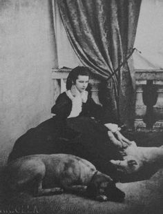 Empress Elizabeth sitting on the floor with her dogs.