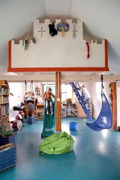 Children's beds on mezzanine level with playing space below