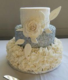 Silver and White Ruffle Wedding Cake. Wedding Cake. Wedding Trends. White Ruffle Cake. Ruffle Cake. Silver Wedding Cake. Wedding Planning.