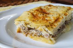 Musaka is a Serbian dish similar to the Greek Moussaka, but made with potatoes instead of eggplant. Potatoes are sliced and layered with ground beef or pork, then covered in a yogurt egg sauce befo. Greek Recipes, Fish Recipes, Meat Recipes, Cooking Recipes, Bosnian Recipes, Croatian Recipes, Albanian Recipes, European Dishes, Musaka
