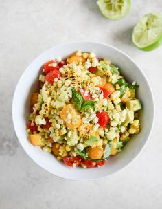 Easy Grilled Corn Tomato Salad with Blue Cheese and Basil Ribbons I howsweeteats.com