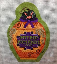 Putrid Pumpkin Poison Bottle by Kirk & Bradley. Stitched to perfection by Amy Bunger!