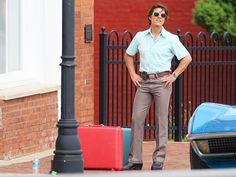 "Tom Cruise struck a pose with suitcases full of money on the set of ""Mena,"" in which he plays infamous drug smuggler Barry Seal, in Ball Ground, Ga., on Tuesday, June 2."