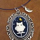 Owl cameo in silver swirl and star setting with moon man charm