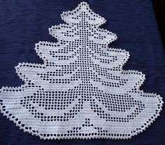 Need something special this holiday season? This pretty tree doily will do job. Tree is made from white cotton thread #10 with one line of silver edging. It will make your holiday table looking festive or it will make nice gift for someone special. This doily also can be made in big table topper by connecting six trees together like shown in photo. Custom orders welcome. It is machine washable, lay flat to dry, touch up with iron and spray starch if desired. Approximate size is 16x16 Th...