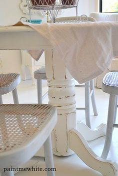 pretty painted white... table and chairs this one mom but with black instead of the wood tones for the distressing